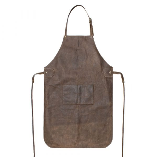Leather Apron flat image showing the neck strap and tie around strap. APron in a distressed brown leather