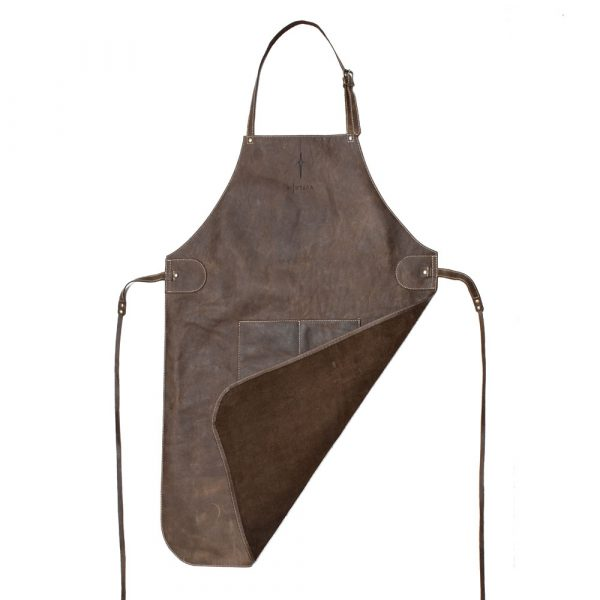 Leather Apron flat image with a turner over corner showing the unlined fluffy leather side. Apron in a distressed brown leather